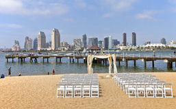 Wedding preparations on Coronado Island San Diego California. San Diego - June 1st 2013: A view of The San Diego skyline and a wedding preparation setup on a stock photography