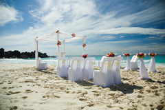 Wedding preparations outdoors, at tropical sandy beach Royalty Free Stock Photography