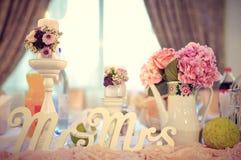 Wedding presidential table arrangement. A Mr & Mrs sign on a wedding presidential table Royalty Free Stock Image