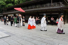 Wedding Procession in the Meiji Shrine in Tokyo. At the Meiji Shrine in Tokyo, one is likely to witness a traditional wedding procession. Leading the way are Royalty Free Stock Image