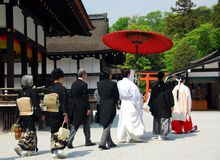 Wedding procession. A procession of a traditional Japanese wedding at Shimogamo Shinto shrine, Kyoto, Japan stock image