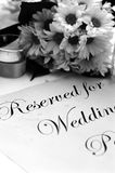 Wedding program. Detail of bouquet & wedding program