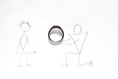 Wedding proposal - man on one knee giving ring to a woman Stock Photography