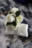 Wedding Purse and flowers. Wedding Purse and white roses on rug Stock Photos