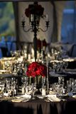 Wedding Reception. A wedding reception table setting with a red rose bouquet Royalty Free Stock Photo