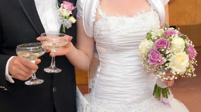 Wedding reception. Bride and groom with champagne glasses Royalty Free Stock Image