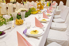 Wedding reception. Table setting at a luxury wedding reception Stock Photo