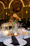 Wedding reception. Indoor wedding reception table with candles and floral centerpieces Stock Photo