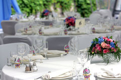 Wedding Reception. A general view of a table at a wedding reception. The table is beautifully arranged with some flowers, and you can see all the place settings Royalty Free Stock Photography
