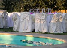 Wedding reception. By the pool, closeup of catering setup Stock Photos