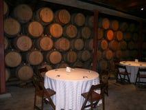 Wedding reception area at a winery. Wedding reception at a winery with wine barrels and round tables Royalty Free Stock Photos