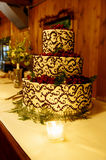 Wedding reception cake. Detail shot of a multi-tiered wedding cake on a reception table Stock Image