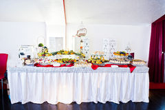 Wedding reception catering table with different fruits and cakes Royalty Free Stock Photos