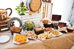 Wedding reception catering table with different snaks. Stock Images