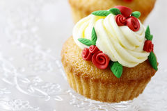 Wedding reception cupcakes decorated with sugarcraft red roses Royalty Free Stock Image