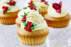 Wedding reception cupcakes decorated with sugarcraft red roses Stock Photos