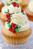 Wedding reception cupcakes decorated with sugarcraft red roses Royalty Free Stock Photography
