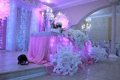 Wedding reception decoration in white and pink colours stock images