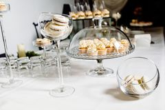 Wedding reception dessert table with delicious decorated white c royalty free stock photography