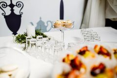 Wedding reception dessert table with delicious decorated white c royalty free stock images