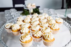 Wedding reception dessert table with delicious decorated white c stock photo