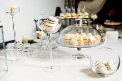 Wedding reception dessert table with delicious decorated white c royalty free stock photos