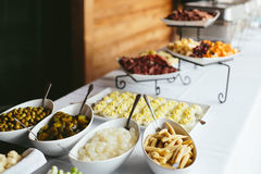 Wedding Reception Dinner Food Buffet. Modern wedding reception dinner buffet with food including, cheeses, deviled eggs, cold cuts meat, pickles Stock Photos