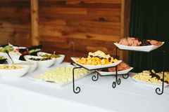 Wedding Reception Dinner Food Buffet. Modern wedding reception dinner buffet with food including, cheeses, deviled eggs, cold cuts meat, pickles Royalty Free Stock Images