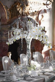 Wedding reception with floral arrangement of white orchids.  Stock Photo