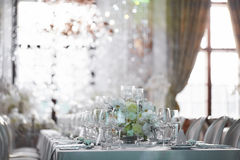 Wedding reception with floral arrangement of white orchids.  Royalty Free Stock Image