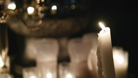 Wedding reception hall with decor including candles stock video