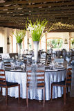 Wedding reception hall with gorgeous flower bouquets Stock Photography