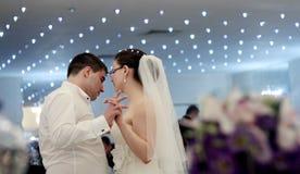 Wedding reception. Melancholic newlyweds dance at wedding reception stock photography