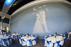 Wedding reception party venue. A room of tables set for a party or wedding reception royalty free stock images
