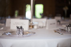 Wedding reception place setting detail 2. Wedding reception place setting detail with gift and plate stock photo