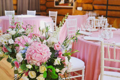 Wedding reception at restaurant with flowers royalty free stock photography