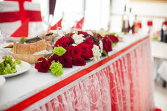 Wedding reception table closeup of red freshly cut roses decorat Stock Photo