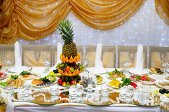Wedding reception table with food stock images