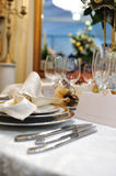 Wedding reception table with glasses and plates Royalty Free Stock Photos