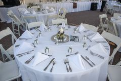 Wedding reception table with place settings. stock photography