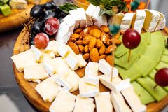 Tasting cheese dish . Delicious cheese on the table. Table setting at a luxury wedding reception. stock image