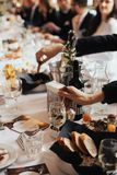 Wedding reception. Table setting in restaurant. Woman`s hand with fork Stock Photography