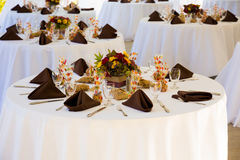 Wedding Reception Tables. Tables are set and ready for a wedding reception in Oregon Stock Photo