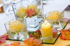 Wedding reception tables. Vase of pink roses and candles Stock Photos
