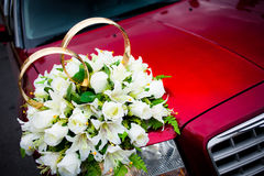 Wedding red limousine. Close-up of wedding red limousine with betrothal rings and flowers Royalty Free Stock Photos