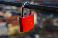 Wedding red lock with heart on a handrail. Stock Photo