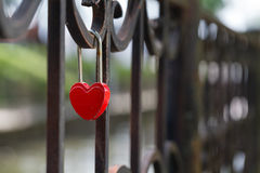 Wedding red lock with heart on a handrail. Symbol of marriage. royalty free stock images