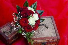 Wedding red and white roses bouquet. Bridal bouquet with red and white roses on wooden boxes stock photos