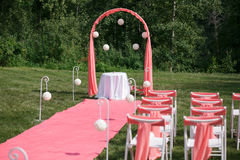 Wedding registration beautiful in nature. White chairs for visiting registration. Pink tent with white flowers for the Stock Photos