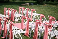 Wedding registration beautiful in nature. White chairs for visiting registration. Pink tent with white flowers for the Royalty Free Stock Images